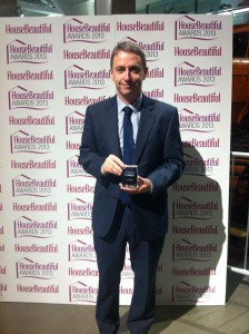 Eamonn Prescott with the Silver award for 'Best Carpet'
