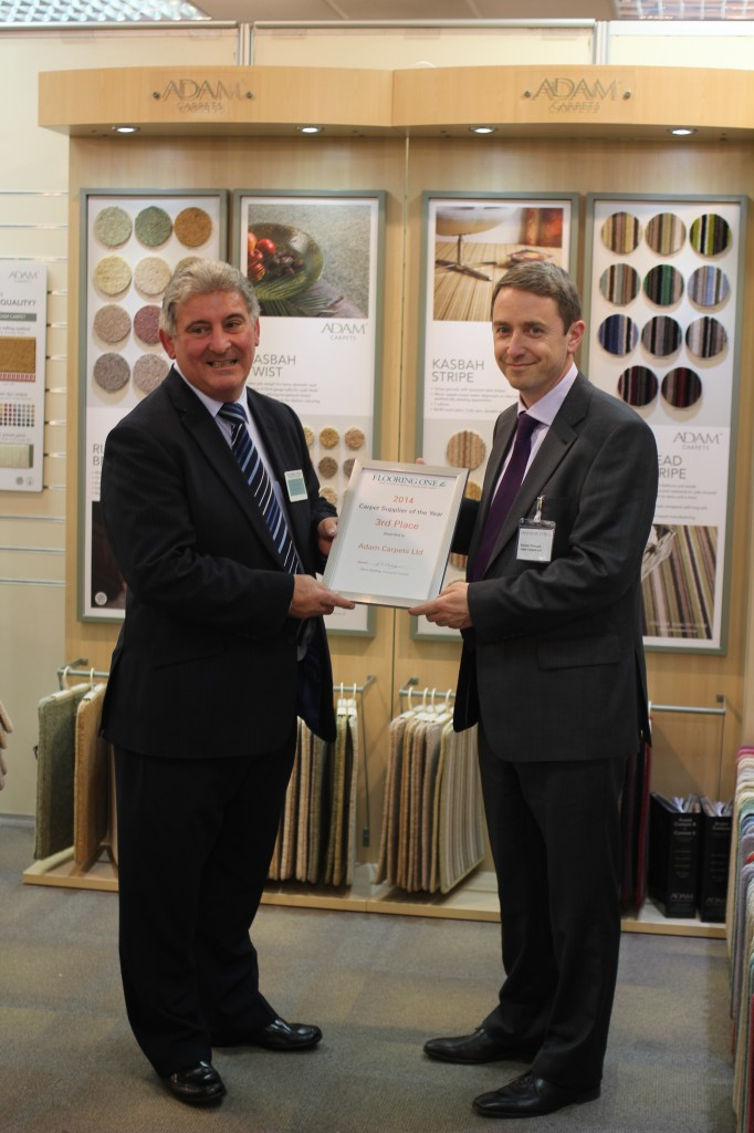 Flooring One Controller, Glenn Harding presenting the award to Eamonn Prescott of Adam Carpets